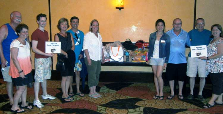 Senn Delaney employees with Pack for a Purpose supplies at Fairmont Mayakoba
