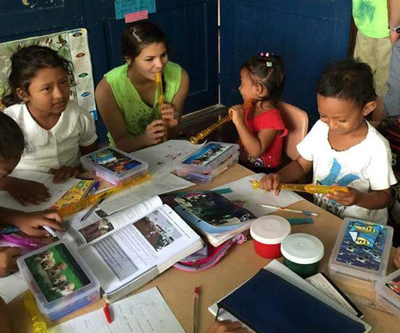 Students at Local School Working With Volunteer Students