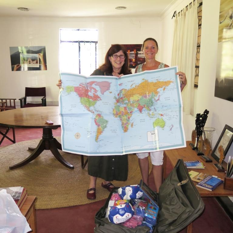 Amanda and Rebecca with supplies delivered to Nomad Tanzania