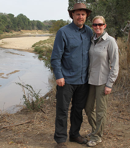 Stacy and her husband by a river in South Africa