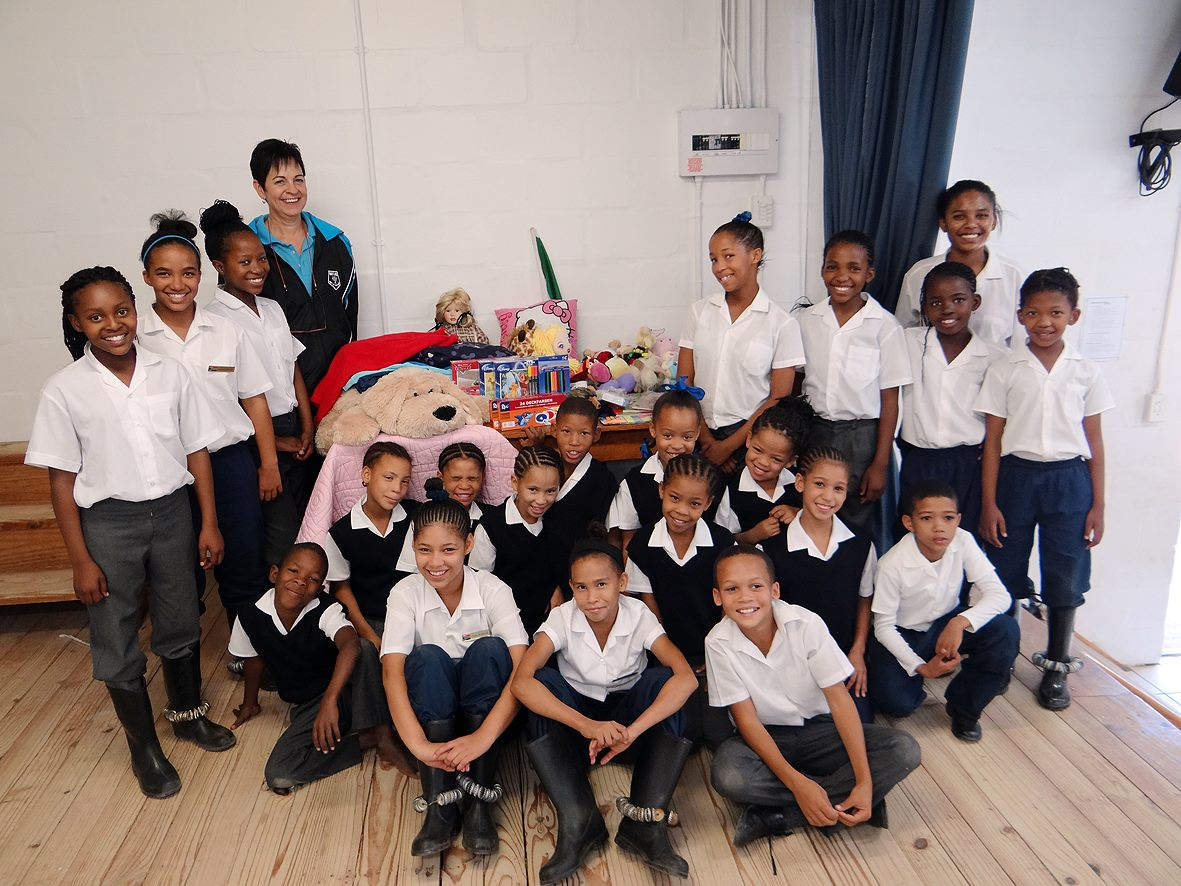 Guests with students and supplies at Elizabethfontein Primary School