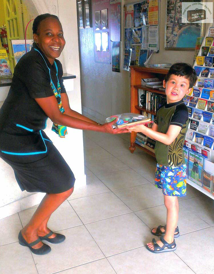 Child handing off supplies at the front desk