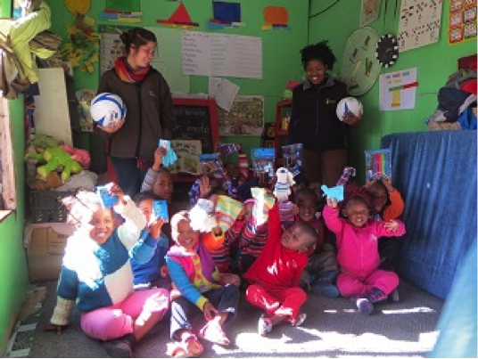 African Game Lodge - children with supplies