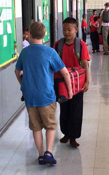 Students-carrying-luggage-for-web